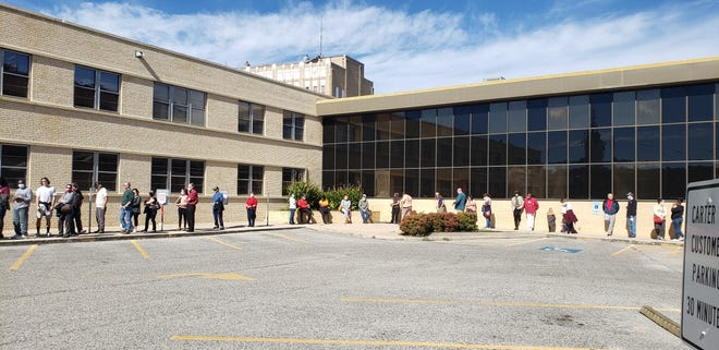 The line for early in person voting wraps around the courtyard outside the Carter County Election Board on Saturday afternoon.