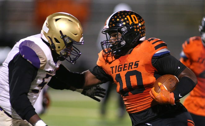 Beaver Falls' Joshua Hough (10) stiff arms Western Beaver's Montae Reddix (57) during the first half Friday night at Reeves Field.