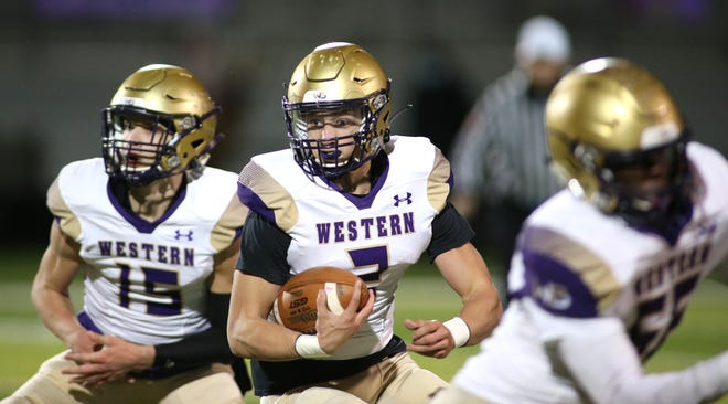 Western Beaver's Thad Gray (2) runs downfield during the first half of a WPIAL playoff game against Beaver Falls. Golden Beavers' defensive coordinator Ron Busby is the team's new head coach.