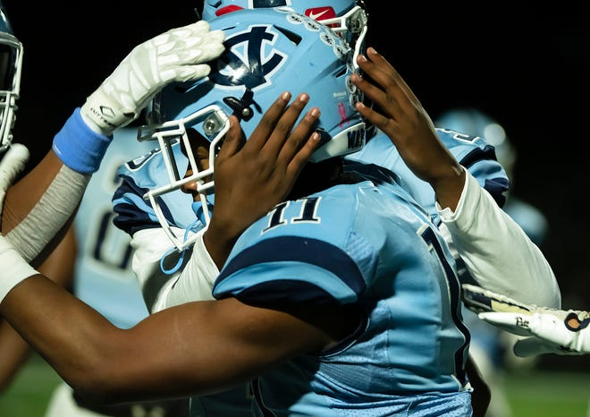Central Valley's  Amarian Saunders is congratulated by his teammates after his touchdown in the first quarter.