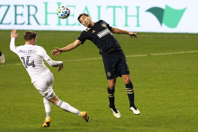 Philadelphia Union's Alejandro Bedoya, right, and Chicago Fire's Djordje Mihailovic go after the ball during their MLS match Wednesday. [Charles Fox/The Philadelphia Inquirer via AP, File]