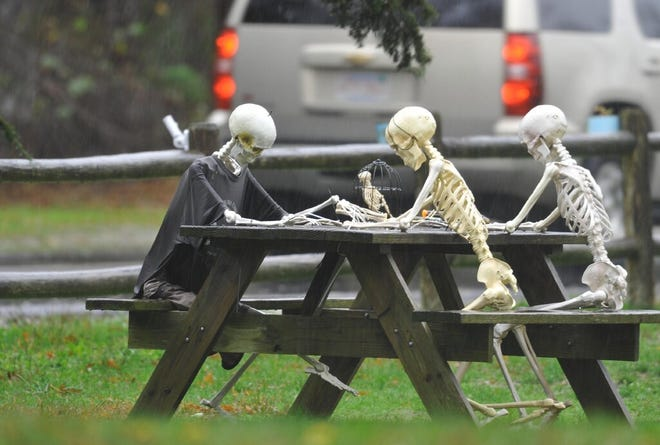 SANDWICH -- Undeterred by a northeast gale and lack of social distancing, the skeleton family gathers around the table at the Shipwreck Ice Cream shop.