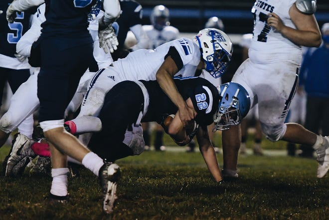 Tolton's Max Brucks (22) carries the ball against Paris on Friday night at Paris High School.