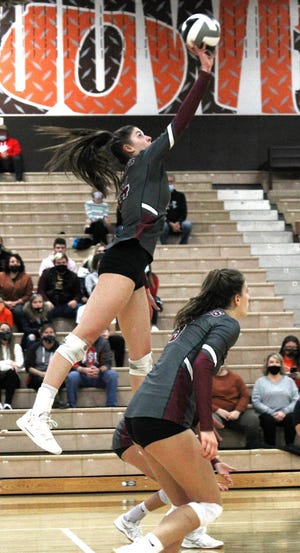 John Glenn senior Abigail Walker (24) collects one of her game-high 30 kills during Saturday's Division II district championship match with Meadowbrook. Walker was named the MVL Big School Division player of the year.