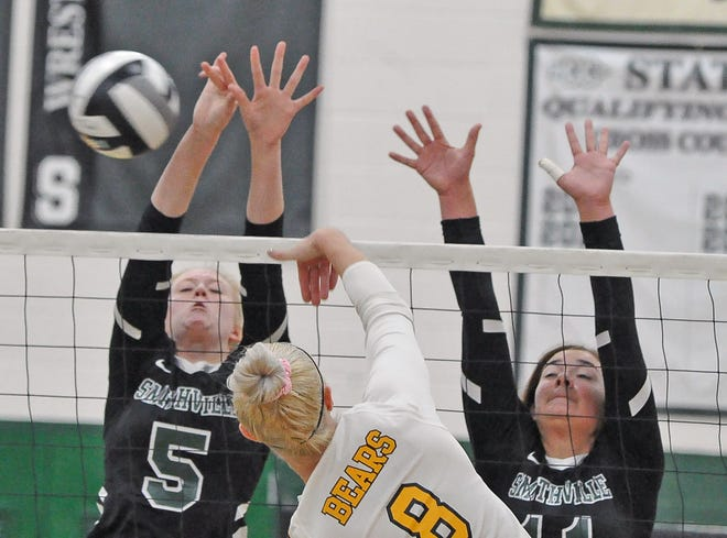 Smithville's Brooke Fatzinger (left) battles Waynedale's Sara Ice (middle) at the net during their district final matchup. Both players are first-team All-Daily Record honorees.