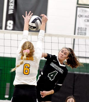 Brooke Karlen tries to power through Kelsey Wolfe's block during Smithville's district title win over the Bears.