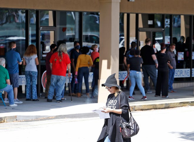 Voters line up outside the Supervisor of Elections Office in DeLand to cast their ballot on the final Saturday of early voting. In Volusia County, early voting continues until 7 p.m. on Sunday, while early voting has closed in Flagler County.