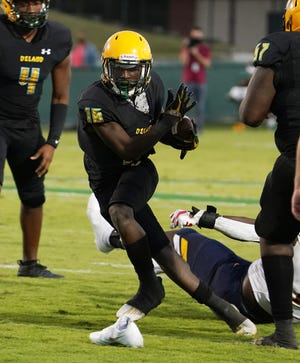 Javon Ross (16) and DeLand fell 31-7 to Fort Lauderdale St. Thomas Aquinas, the reigning champion of Class 7A, on Friday night.