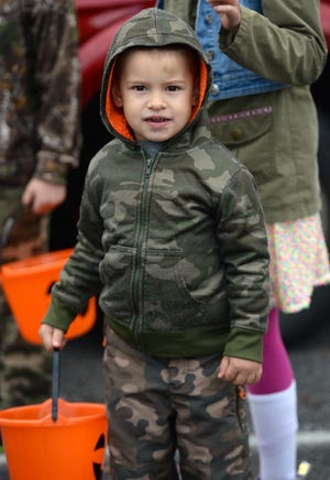 Findley Pettis, 2, of Millcreek Township, attends the drive-through trunk-or-treat event for kids Saturday at the Fairview United Methodist Church.