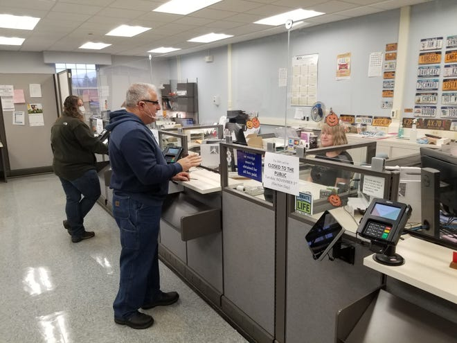 Residents handle business at the Allegany County DMV.
