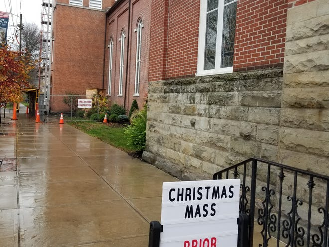 A sign outside of St. Ann's Church in Hornell reminds parishioners to make an online reservation for holiday services.