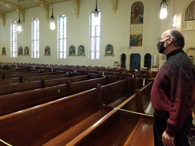 Father Stan Kacprzak, pastor of the Our Lady of the Valley Parish, surveys the pews at St. Ann's Church in Hornell.