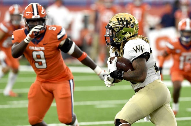 Wake Forest Demon Deacons running back Christian Beal-Smith (26) carries the ball during the first half of Saturday's game against Syracuse in the Carrier Dome.