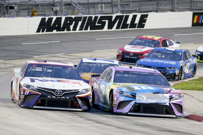 Denny Hamlin (11) and Kyle Busch (18) come through a turn during a June 10 race at in Martinsville, Virginia. They return to Martinsville Speedway, NASCAR's oldest and shortest track, for the final Cup playoff elimination race Sunday.