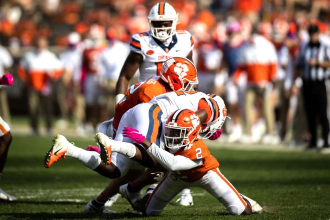 Syracuse running back Markenzy Pierre is tackled by Clemson cornerback Fred Davis II during an Oct. 24 game in Clemson, South Carolina.
