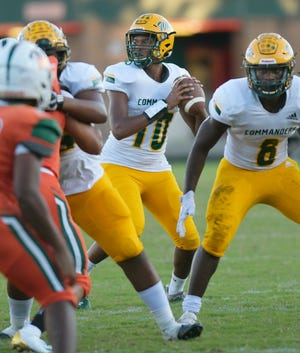 Ed White quarterback Isiah Teal (10) drops back to pass against Mandarin during a 2020 high school football game.