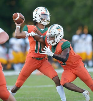 Mandarin quarterback Tre Lawrence prepares to pass during an Oct. 30 game against White. The Mustangs open the Region 1-8A playoffs against Sandalwood.