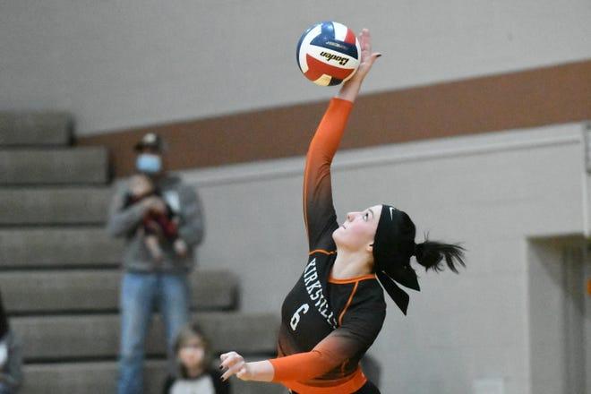 Kirksville senior Emily Middleton serves during Saturday's state sectional match against John Burroughs.
