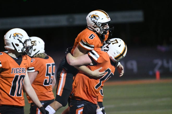 Kirksville's Pearce Crawford hoists up Jaden Ballinger after Ballinger caught an interception on defense