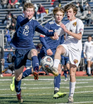 Hudson midfielder Sean Durkin and Walsh Jesuit's Pryce Pitchford compete for the ball during the Explorers' 5-1 win in a Division I district final game Oct. 31 at Hudson Memorial Stadium.