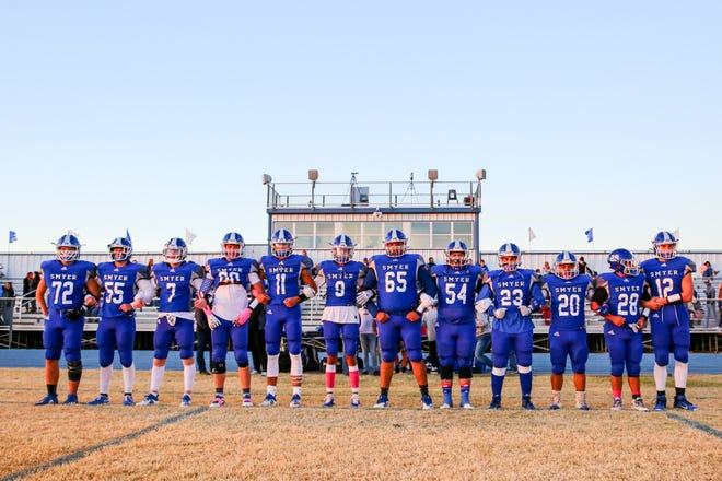 Smyer captains wait to take the field before a District 2-2A Division II game against Sudan on Oct. 30 at Bobcat Stadium in Smyer.