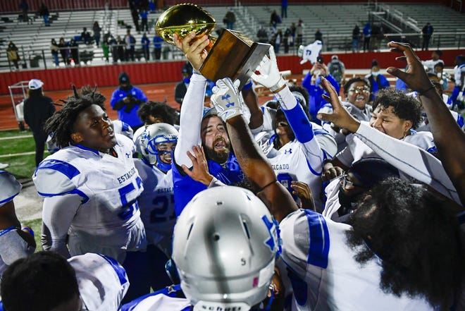 Estacado celebrates winning the District 3-4A Division II trophy after defeating Levelland 41-24 on Friday Oct. 30, 2020, at Lobo Stadium in Levelland.