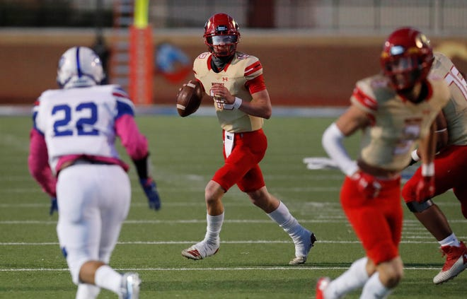 Coronado quarterback Sawyer Robertson (12) looks for an open receiver in the first half of a District 2-5A Division I game, Friday, October, 30, 2020, against Palo Duro at PlainsCapital Park at Lowrey Field.