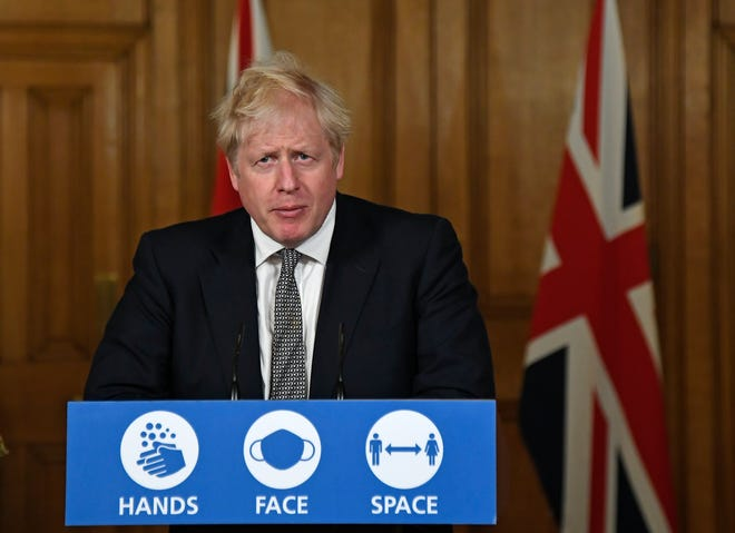 Britain's Prime Minister Boris Johnson speaks during a press conference in 10 Downing Street in London on Saturday where he announced new restrictions to help combat a coronavirus surge.