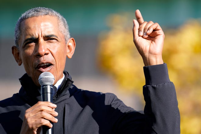 Former President Barack Obama speaks at a rally for Democratic presidential candidate former Vice President Joe Biden at Northwestern High School in Flint, Mich., on Saturday.