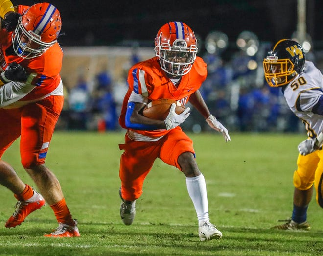 Bartow running back Darriell Davis rambles through the hole opened by the line to score against Winter Haven during the high school football game at Memorial Stadium in Bartow on Friday.