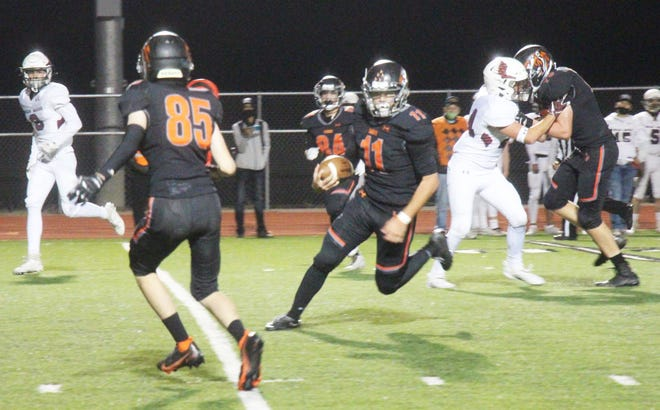 La Junta High School's Luke Garner (11) runs with the ball en route to the Tigers' first touchdown of Friday's game against Alamosa at Tiger Stadium. The Tigers defeated the Mean Moose, 42-12.