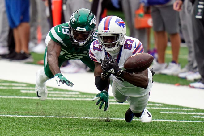 The Buffalo Bills and Tre'Davious White, right, are set to take on the New England Patriots. White said he doesn't miss having Tom Brady with the Patriots.