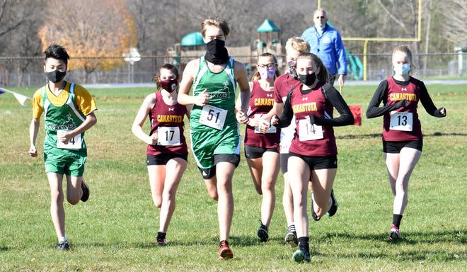 Local boys and girls cross-country teams competed in the Center State Conference Cross-Country Championships Saturday, Oct. 31, 2020 at West Canada Valley High School in Newport. New York Mills senior Victor Lee won the boys meet, and Oriskany junior Paris Welker won the girls event.