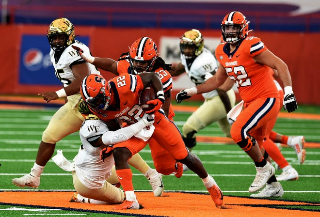 Syracuse running back Markenzy Pierre (22) tries to slip past a defender during the first half against Wake Forest on Saturday at the Carrier Dome. (Dennis Nett/The Post-Standard via AP)