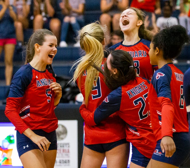 Vanguard's Sophie Reed and her teammates celebrate their win in the third set. The Vanguard Knights defeated the Fivay Falcons in three straight sets, 25-16, 25-19 and 25-13 in the Class 5A, Region 2 finals on Saturday.