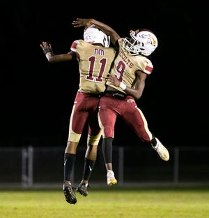 North Marion's Jeriahmiah Mack celebrates his interception against Belleview with teammate Quintin Gross on Friday. The Colts beat the Rattlers 38-13.