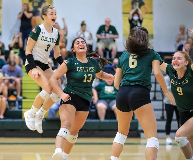 Trinity Catholic's Kiana Laborde (13) celebrates with teammates after scoring the final point to advance the Celtics to the state semifinals.