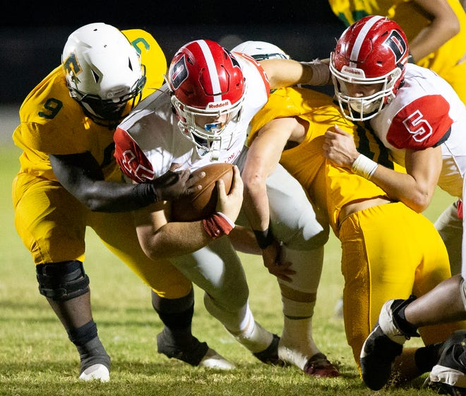 Dunnellon's Trent Townsend drives forward for a first down in the first half. The Dunnellon Tigers defeated the Forest Wildcats 10-7 Friday night.