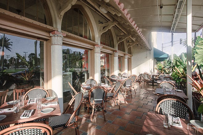 Almond's al-fresco, covered patio features Spanish terra-cotta tile and landscaping by Palm Beach landscape architect Mario Nievera.