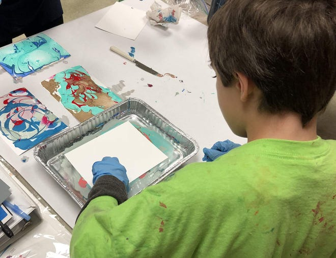 A Birchtree Center student makes art of the autism learning center's 2018 annual auction. The center is offering an Online Autism Q&A Wednesday, Nov. 4 at 6 p.m.