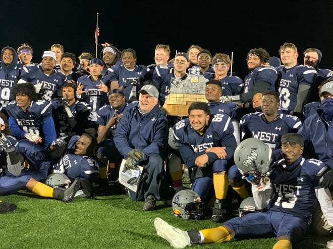Pocono Mountain West High School's football team celebrates a 7-6 overtime victory over Pocono Mountain East on Friday, Oct. 30, 2020 in Pocono Summit.