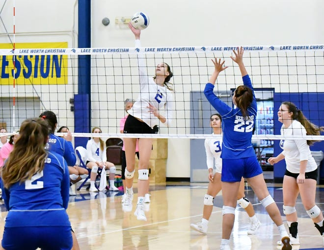 Lake Worth Christian sophomore Abby Toeniskoetter fires the ball across the net in the first set of Saturday's regional finals victory against Miami-Westwood Christian. Toeniskoetter finished with eight blocks and seven kills.