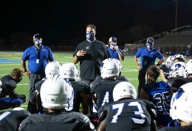 Wellington head coach Tom Abel speaks to the team after the end of the game between Wellington and Royal Palm Beach in Wellington, FL, on Friday, October 30, 2020. Final score, Royal Palm Beach 26, Wellington, 21.