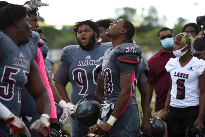 Palm Beach Lakes' Joshua Weatherton (38) hypes up his teammates before the start of a game against Palm Beach Gardens this past season. Lakes is moving up to 8A this upcoming season.