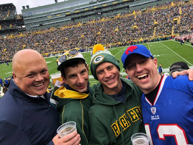 Kevin McGreevy, right, was smiling before the Buffalo Bills took on the Green Bay Packers in 2018 on a pilgrimage to Lambeau Field with friends, including Journal sports writer Eric Rueb, left. Final score that day? Packers 22, Bills 0.
