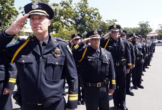 Deputy Police Chief Trevor Womack, left, salutes alongside other officers during San Joaquin County's 2019 Peace Officers' Memorial. Womack has been selected by the city of Salem, Ore., as its next police chief.