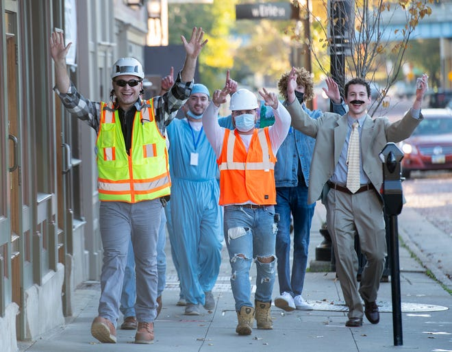 Halloween brings revelers to Downtown Kent on Saturday. A group of construction workers, a doctor, Bob Ross and Borat walk Franklin Avenue to Ray's Place.