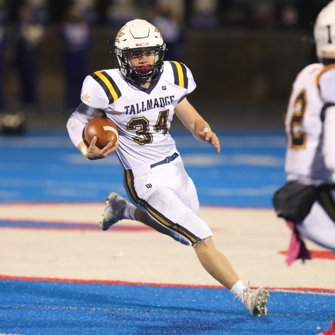In this file photo, Tallmadge senior Cole Thomas rushes the ball in a game last season.