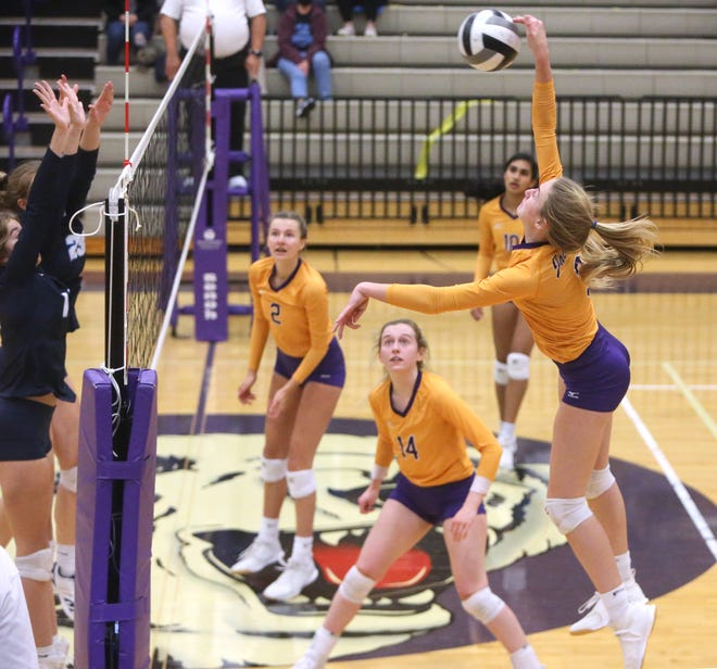 Sydney Wake (right) of Jackson goes for the kill during their Division I district final at Jackson on Saturday, Oct. 31, 2020.