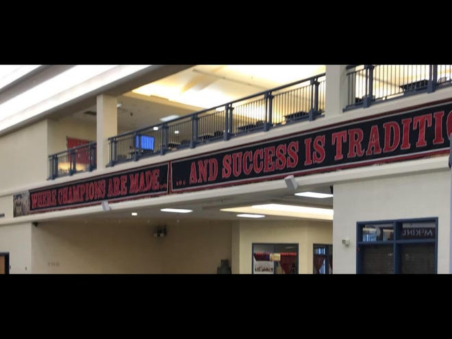 A historical mural in what's known as the Timken Commons inside McKinley High School's downtown campus has been covered by a banner after concerns were raised about the mural's depiction of slavery.